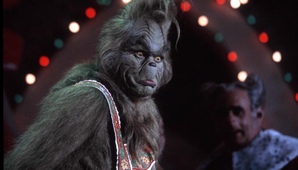 GRINCHEN: Under innspillinga av «Grinchen» gikk Jim Carrey i kostymet i 92 dager. Hver morgen ble det brukt to og en halv time på å få ham sminket og inn i kostyme, før det tok en time å få ham ut igjen når arbeidsdagen var over. Over 1000 arbeidstimer ble brukt på sminke i filmen.FOTO: NTB Scanpix