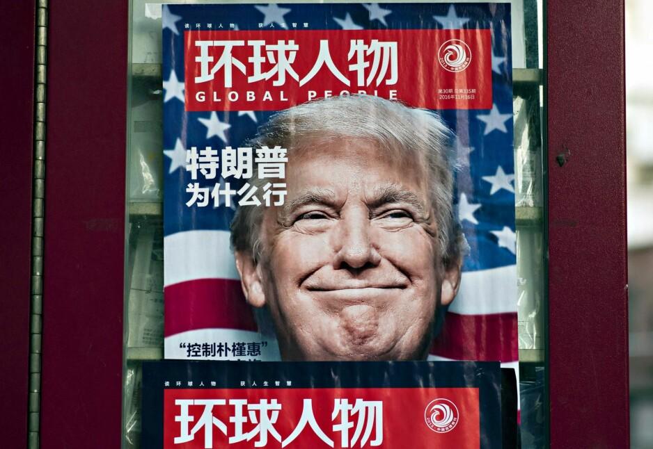 TRUMP I FOKUS: Hele verden deltar i gjetteleken om hvilken politikk han kommer til å føre på vegne av USA. Her pryder han forsiden på et kinesisk nyhetsmagasin.   Foto: AFP / NTB Scanpix