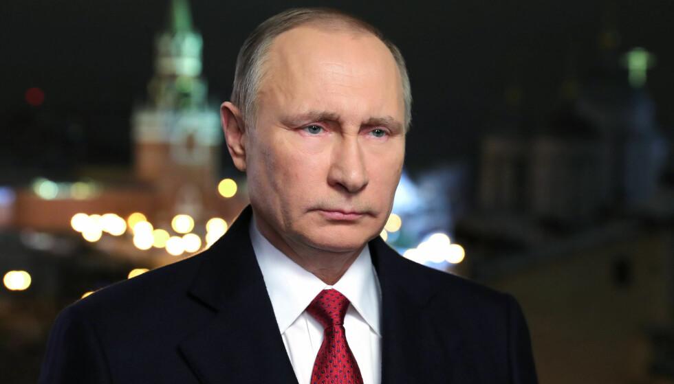President Vladimir Putin ga personlig ordre om cyberangrep for å påvirke valgutfallet i USA, heter det i en nedgradert amerikansk etterretningsrapport. Foto: Mikhail Klimentyev/Kremlin Press Service, Sputnik, via AP.