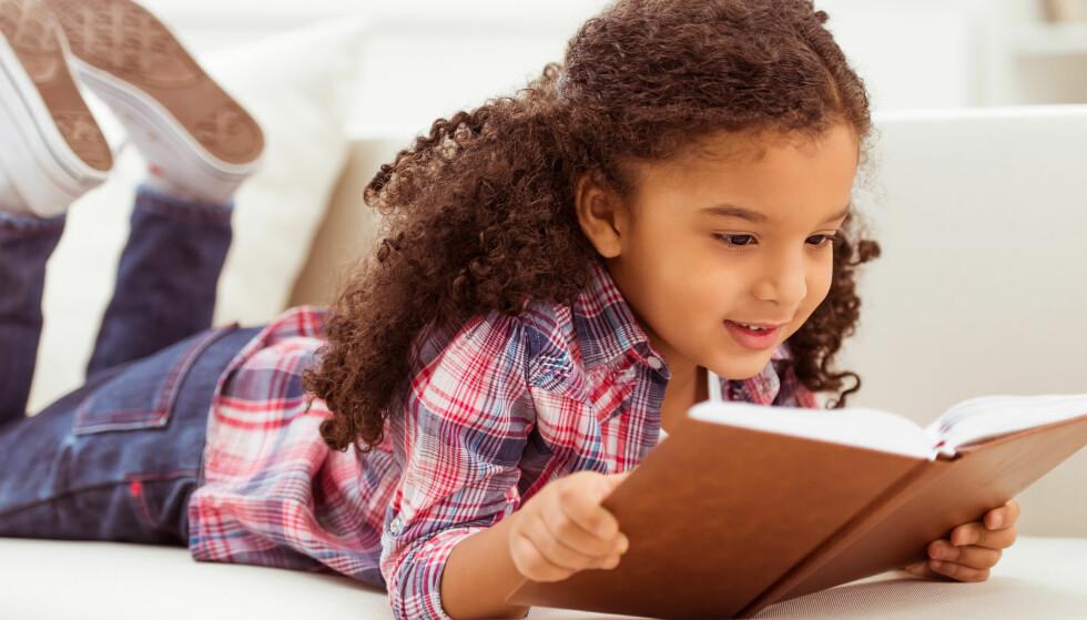 LYSTLESING: Det er når du begynner å lese for moro skyld, at du virkelig har knekt den berømmelige lesekoden. Illustrasjonsfoto: NTB SCANPIX