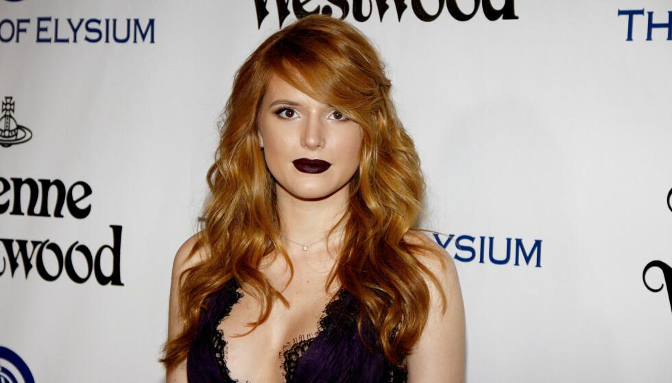 <strong>SNAKKER UT OM DRAPSTRUSLENE:</strong> Den unge Hollywood-stjernen har opplevd å bli truet på livet etter utroskapsrykter. Nå slår hun tilbake. Foto: Scanpix.