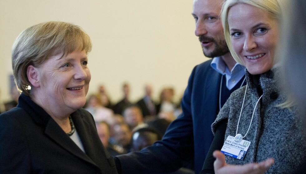 2012: Tysklands forbundskansler Angela Merkel, kronprins Haakon og kronprinsesse Mette-Marit.