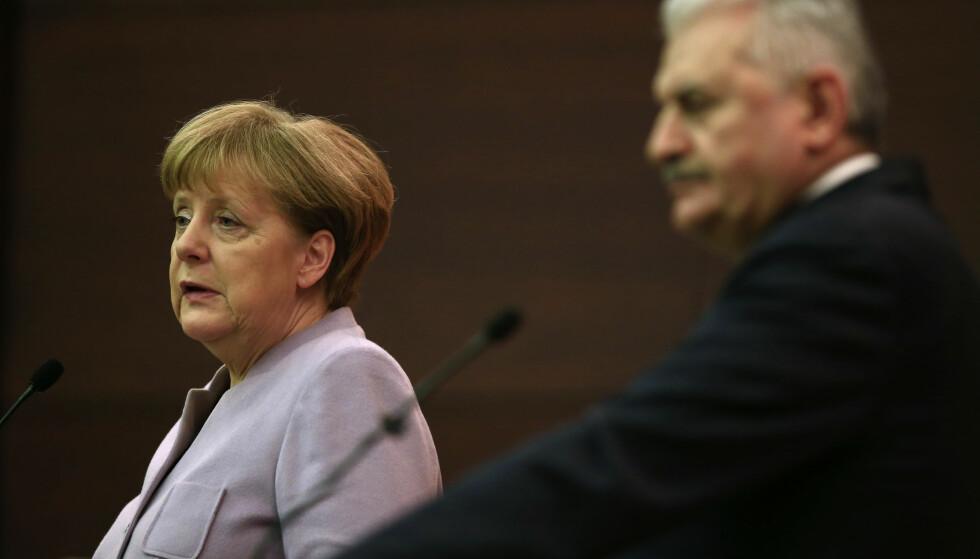 AVTALE UNDERTEGNET: Tysklands forbundskansler Angela Merkel og Tyrkias statsminister Binali Yildirim på en pressekonferanse i Ankara torsdag. Foto: Lefteris Pitarakis, AP/NTB Scanpix.