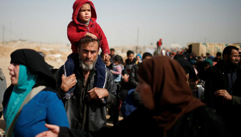 PÅ FLUKT: Så mange som 580 000 mennesker skal være fordrevet fra sine hjem som følge av krigen mot IS. Foto: REUTERS/Suhaib Salem/NTB Scanpix