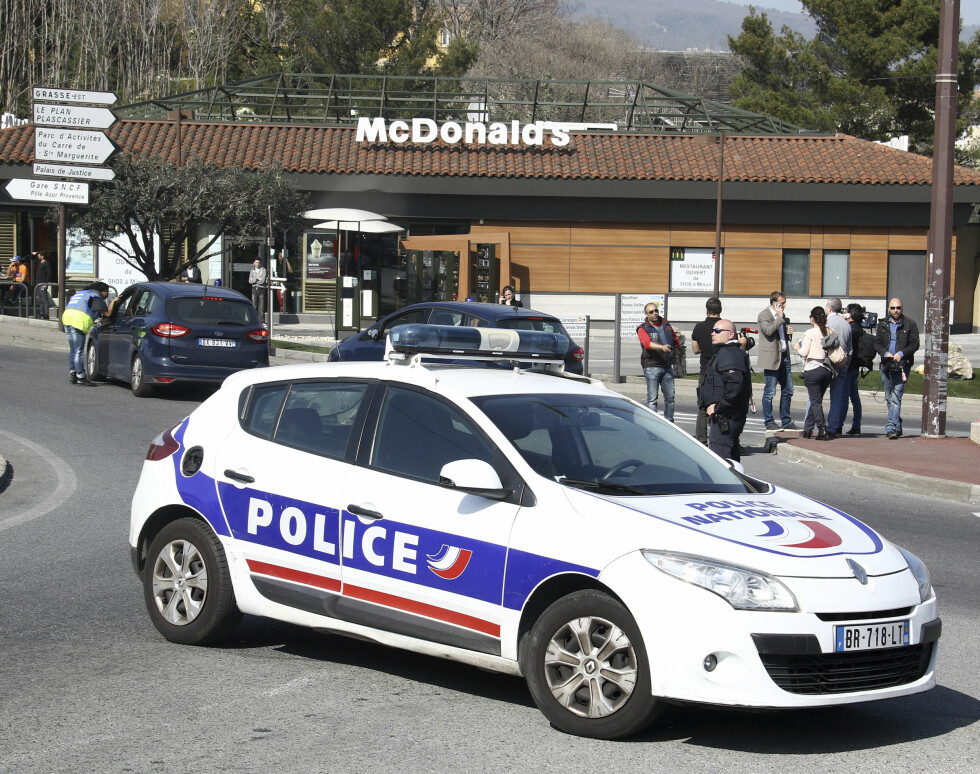 A police car blocks a road after an attack in a high school in Grasse, southern France, Thursday, March 16, 2017. An armed high school student was arrested and police fanned out around a picturesque perfume capital in southern France after a school shooting that left at least two wounded. (AP Photo/Philippe Farjon)