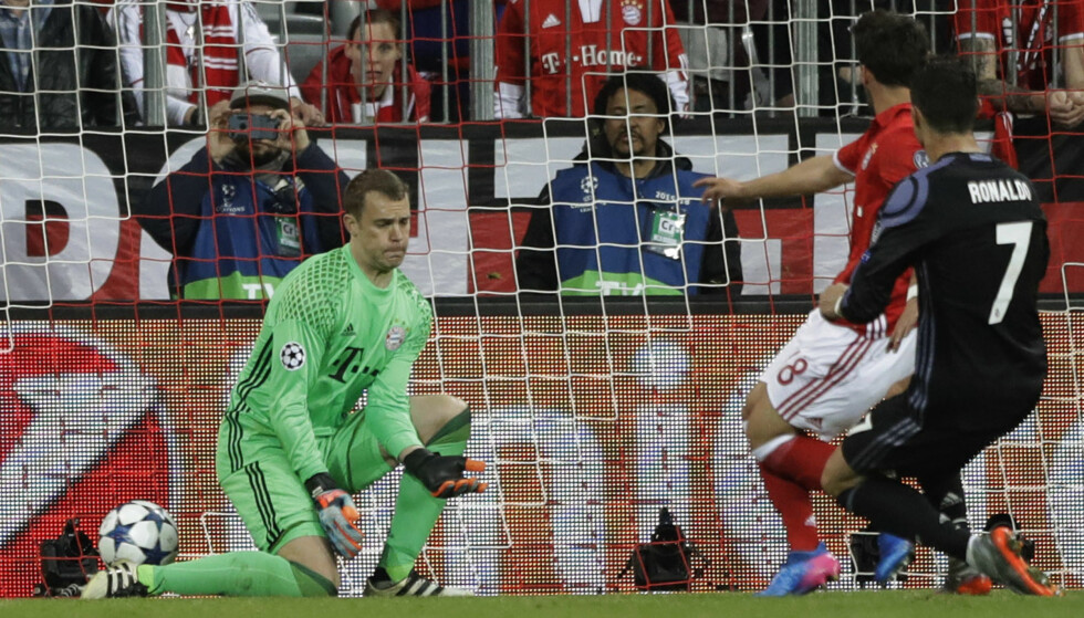 Real Madrid's Cristiano Ronaldo scores his side's 2nd goal during the Champions League quarterfinal first leg soccer match between FC Bayern Munich and Real Madrid, in Munich, Germany, Wednesday, April 12, 2017. (AP Photo/Matthias Schrader)