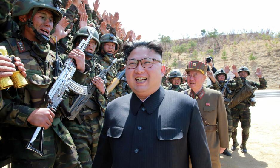 KINA ADVARER: Kinas utenriksminister advarer om konflik og sier at landet ikke vil bidra til å øke spenningsnivået. Foto: Reuters / NTB Scanpix