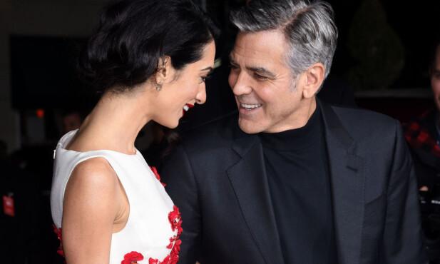 LYKKELIG FORELSKET: George og Amal Clooney på rød løper under verdenspremieren på «Hail, Caesar!» i Los Angeles i 2016. Foto: NTB scanpix