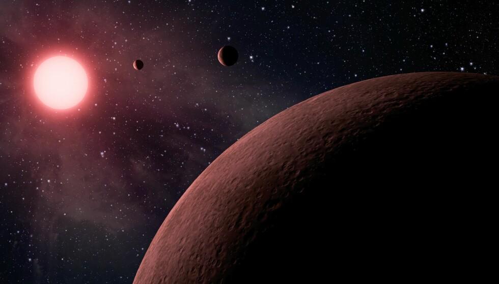 NYE PLANETER: I denne artistiske gjengivelse ses noen av de 219 nye planete, 10 av dem jord-ligenende, som NASA har identifisert. Foto: NASA / JPL-Caltech via AP / NTB scanpix
