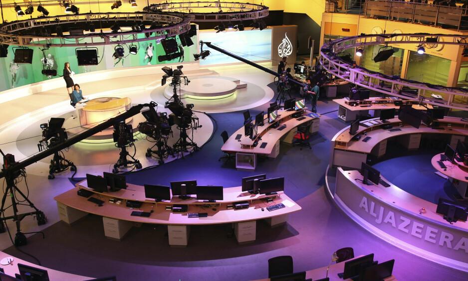 I HARDT VÆR: Saudi-Arabia og tre andre arabiske land krever at Qatar stenger tv-kanalen Al Jazeera. Foto: AP/Scanpix NTB