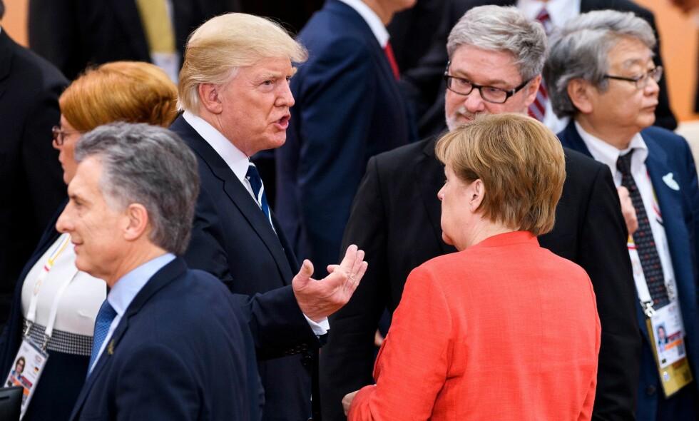 KLIMABUDSKAP: Den tyske forbundskansleren Angela Merkel som er vert for toppmøtet har uttalt at det er spenning knyttet til klimadebatten. Trump deltok bare i deler av samtalen med de andre G20-lederne om klima, men rakk likevel å komme med et klimabudskap. Foto: Scanpix