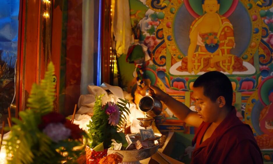 FREDELIGE: Tibetanske buddhister. Foto: NTB scanpix / AFP PHOTO / PRAKASH MATHEMA