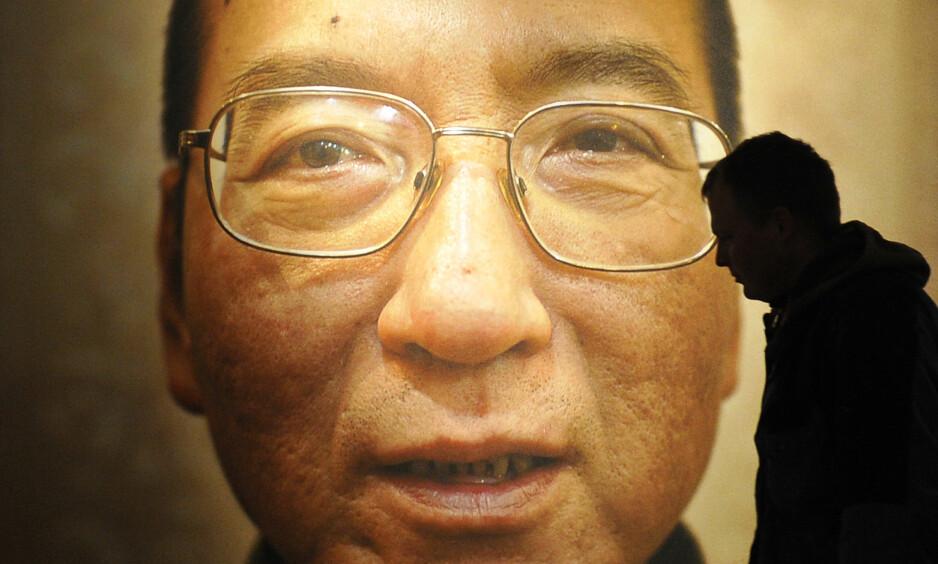DØDE: Den kinesiske dissidenten og fredsprisvinneren fra 2010, Liu Xiaobo, døde i dag, 61 år gammel. Han døde før han fikk sonet ferdig den 11 år lange dommen for kampen han kjempet for ytringsfrihet og politiske reformer. Foto: REUTERS/Toby Melville/NTB Scanpix