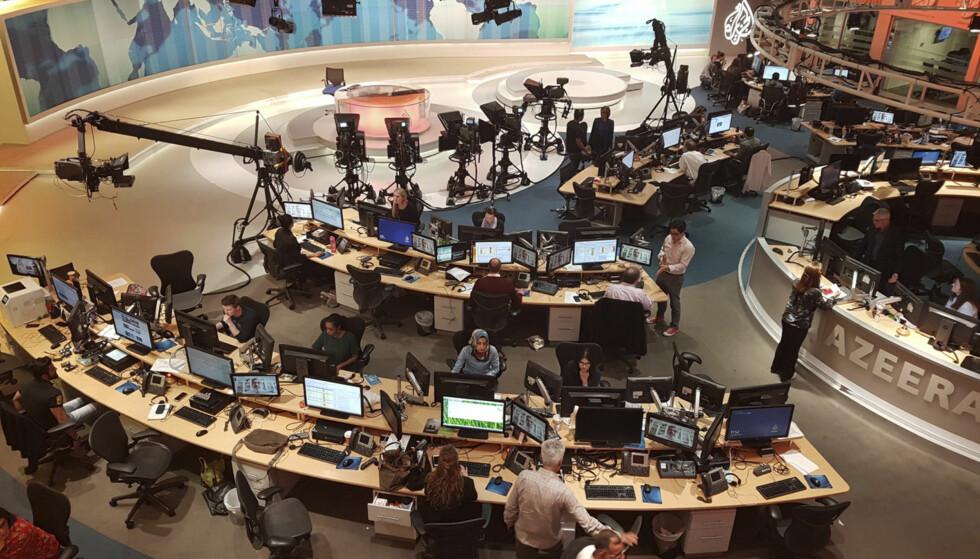 MIDTØSTENS FYRTÅRN: Al Jazeera bruker mye av sendetida på å forsvare Qatar og sin egen eksistens etter at fire arabiske land startet sin blokade i begynnelsen av juni. Foto: AP/NTB Scanpix