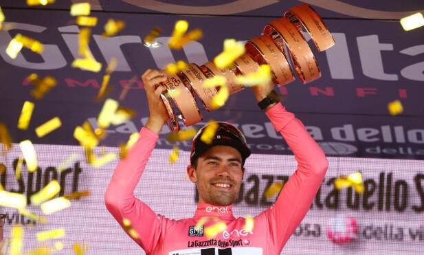 KUNNE JUBLE TIL SLUTT: Tom Dumoulin vant den 100. utgaven av Giro d'Italia - men ikke uten dramatikk. FOTO: AFP PHOTO / Luca Bettini