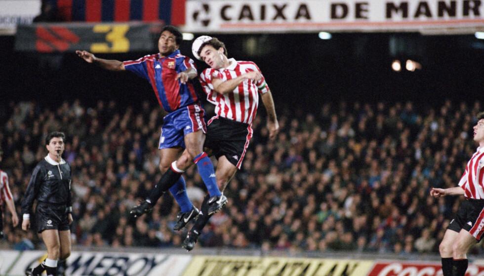 <strong>HØYTSVEVENDE:</strong> Romario kjemper i en duell mot Athletic de Bilbaos Genar Andrinua i en kamp mellom lagene i 1994. Foto: AP Photo/Amilcar de Leon/NTB Scanpix