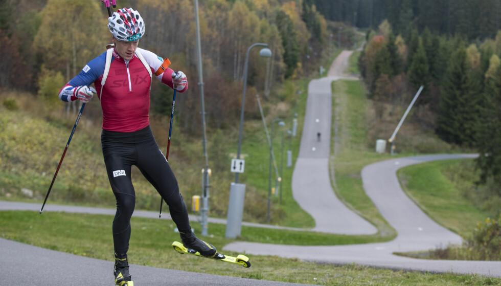 TROR PÅ HJELMESET: Johannes Thingnes Bø har stor tro på Odd-Bjørn Hjelmeset som ny skiskyttersjef. Foto: Vidar Ruud / NTB scanpix