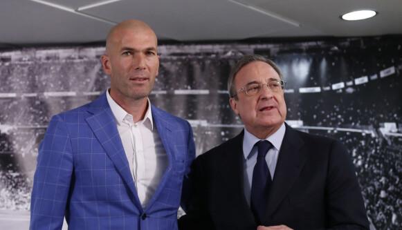 MAKTA I MADRID: Trener Zinedine Zidane (til venstre) og klubbpresident Florentino Pérez har fort mye makt over fremtiden til Haaland og Ødegaard. Foto: AP Photo