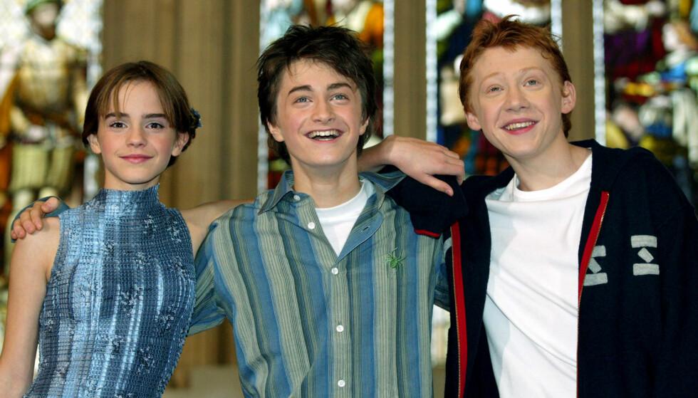 SEES SVÆRT SJELDEN: Over en periode på ti år tilbrakte Rupert Grint, Daniel Radcliffe og Emma Watson utallige timer sammen som en del av «Harry Potter»-filmatiseringene. I et nytt intervju sier Grint at skuespillerne har lite kontakt i dag. Her er trioen avbildet i 2002. Foto: Reuters/ NTB scanpix