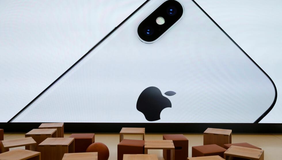 BEKLAGER SEG: Apples produksjonspartner Foxconn brøt kinesiske overtidslover da de lot praktikanter jobbe 11-timersdager for å ferdigstille Iphone X. Foto: Reuters / Elijah Nouvelage / NTB scanpix