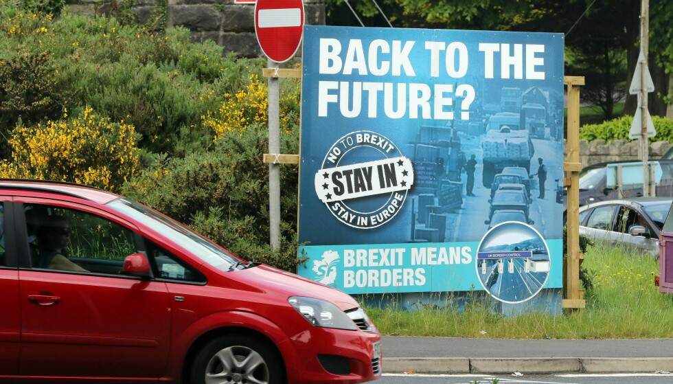 """A """"No To Brexit"""" sign is pictured on the outskirts of Newry in Northern Ireland on June 7, 2016. The border that divides the island of Ireland is now invisible, with just a few crumbling former customs buildings serving as reminders of a bygone era of a hard frontier between north and south. All of this could be about to change. In the event of a Brexit on June 23, these 500 kilometres (311 miles) would become the sole land border between the United Kingdom and the European Union and there are genuine concerns that this will mean the reintroduction of customs barriers that were abolished on January 1, 1993 - and even immigration controls for the first time. / AFP PHOTO / PAUL FAITH"""