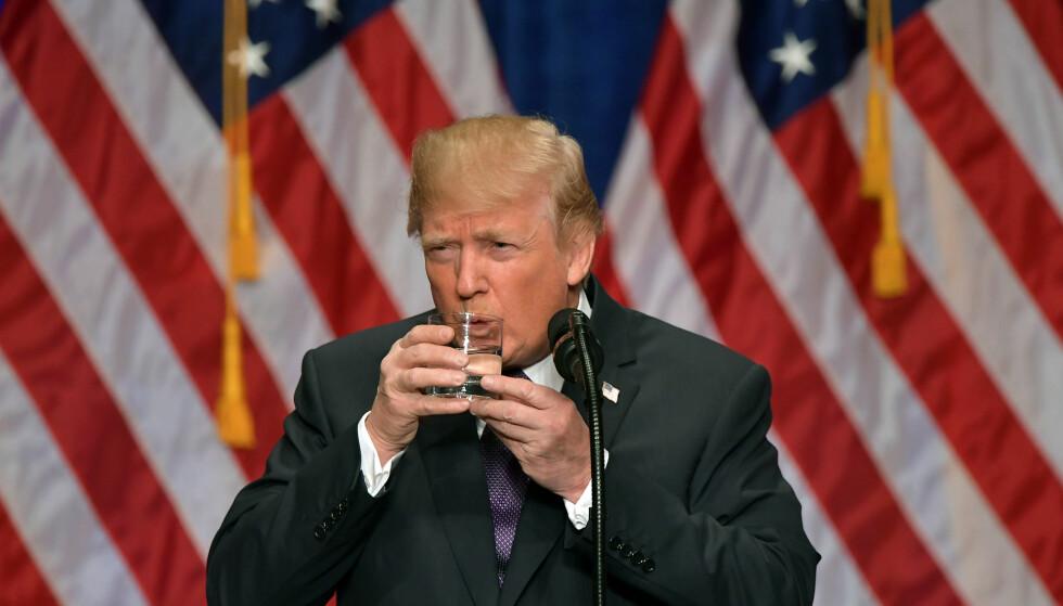 USUNT: Donald Trump tror han har fått fjernet Obamacare. Det stemmer ikke. Foto: AFP PHOTO / MANDEL NGAN