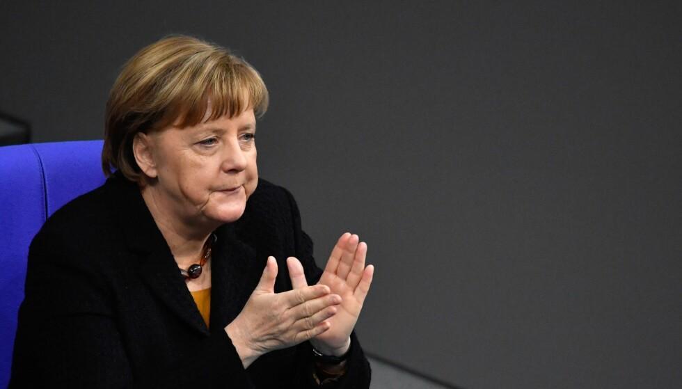 UNNGÅR KRISE: Sosialdemokratene SPD sier ja til å danne koalisjonsregjering med CSU og Angela Merkels CDU, melder den tyske TV-kanalen ZDF. Foto: John MACDOUGALL / AFP / Scanpix