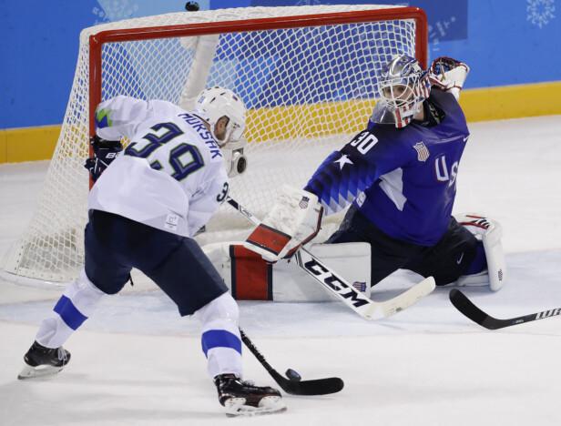 <strong>MATCHVINNER:</strong> Slovenias Jan Mursak scoret det avgjørende målet da de slo USA 3-2 på overtid i den første gruppespillkampen i OL. Før kampen mot Norge i morgen står sloveneren med fem målpoeng på tre kamper, og er nummer to i poengoversikten i OL. Foto: David W Cerny / Reuters / NTB Scanpix