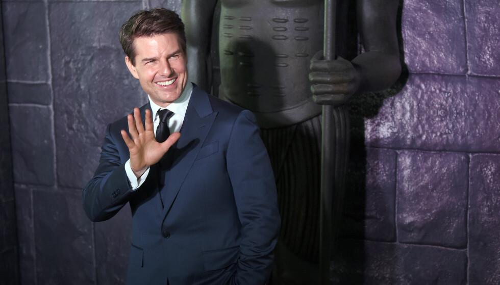 MOTTOK PRIS: Tom Cruise mottok prisen for verste mannlige hovedrolle for den siste «Mumien»- filmen. Her er han under filmens premiere i juni. Foto: NTB Scanpix.
