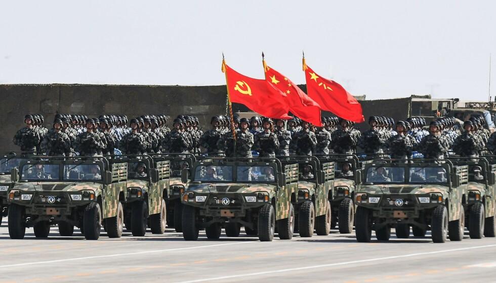 STADIG STERKERE: Kinas væpnede styrker, Folkets frigjøringshær, blir stadig sterkere. Foto: AFP / NTB
