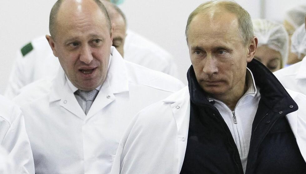 SLUTT PÅ MCDONALD'S: Den russiske oligarken Yevgeny Prigozhin (t.v.) kalles «Putins kokk». Han er en av dem som er rammet av amerikanske sanksjoner. Nå varsler han boikott av McDonald's. Foto: Alexei Druzhinin/Pool Photo via AP, File