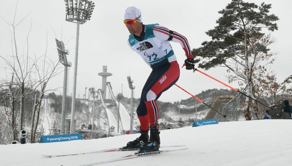 STAFETTGULL: Nils-Erik Ulset, Håkon Olsrud og Eirik Bye tok sølv i åpen stafett i natt. Foto: NTB scanpix
