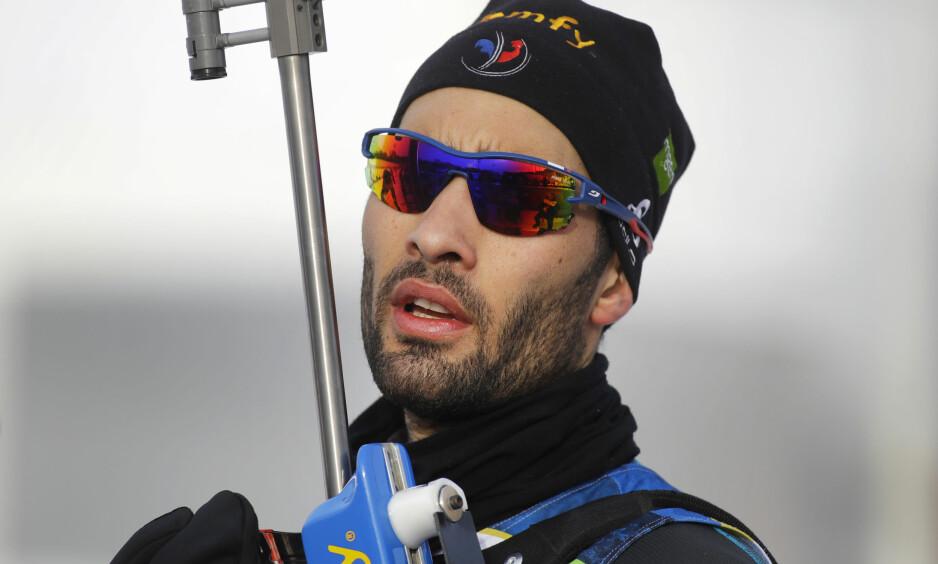 SEIER: Martin Fourcade skjøt fullt og gikk inn til seier i Tjumen, Russland. Foto: AP/Sergei Grits