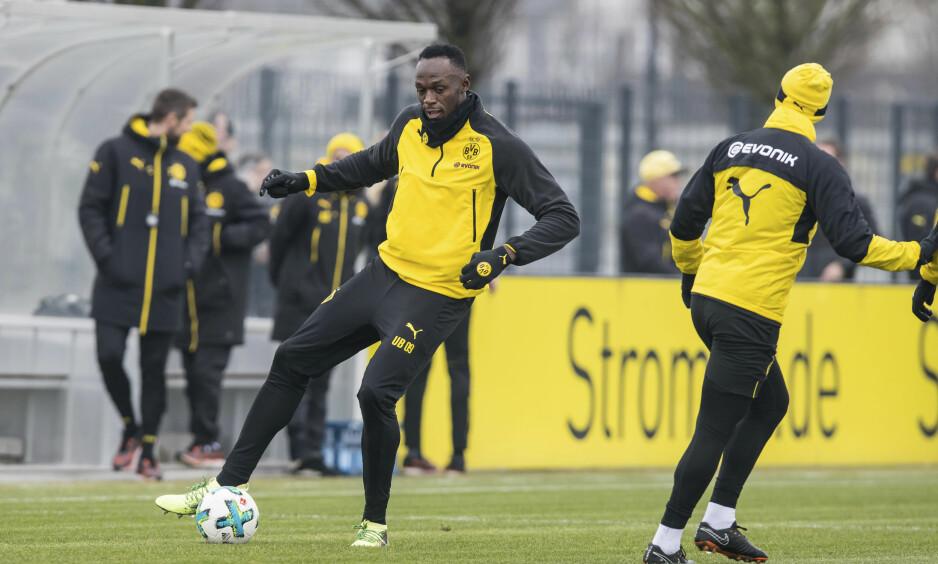 NY KARRIEREVEI: Usain Bolt trener med Borussia Dortmund. Foto: Guido Kirchner/dpa via AP/NTB Scanpix