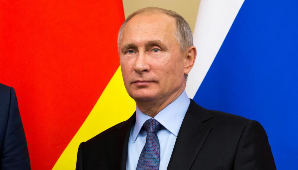 SVARER MED SAMME MYNT: President Vladimir Putin. Foto: Ivan Sekretarev / Reuters / NTB Scanpix