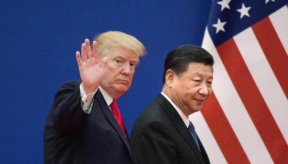 I KONFLIKT: To av verdens desidert mektigste menn, Donald Trump og Xi Jinping, står midt i en opphetet handelskonflikt. Markedene og ekspertene er urolige for hvor det kan ende. Foto: AFP / NTB Scanpix
