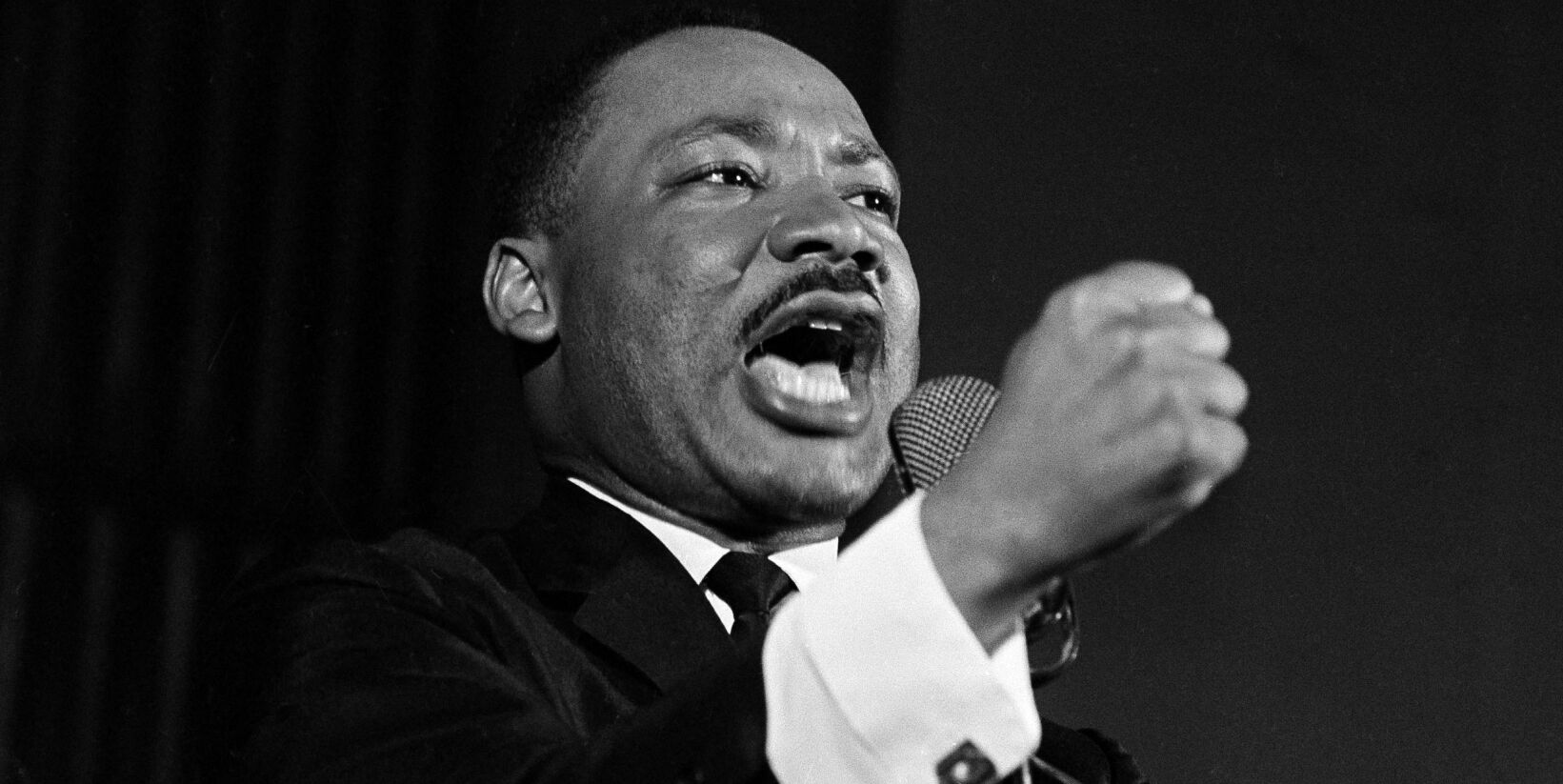 Dr. Martin Luther King Jr. shakes his fist during a speech in Selma, Ala., Feb. 12, 1965. King was engaged in a battle with Sheriff Jim Clark over voting rights and voter registration in Selma. (AP Photo/Horace Cort)