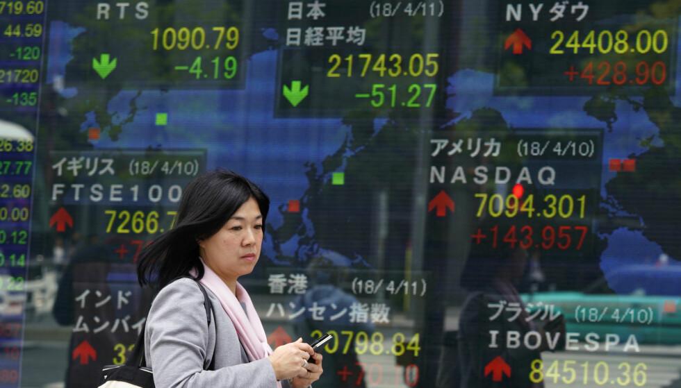 NEDTUR: Aksjemarkedet i Japan gikk nedover fra start torsdag. Foto: AP / Shizuo Kambayashi / NTB scanpix.
