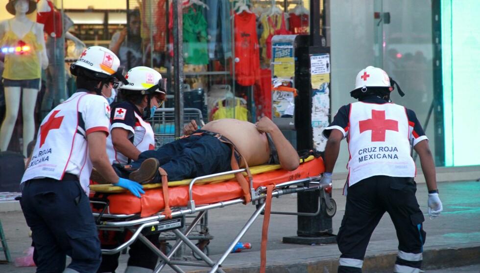 KRIG: Volden i turistfavoritten Cancún har eksplodert den siste tida. I forrige uke ble 14 personer drept på bare 36 timer. Foto: Alonso Cupul / EPA / NTB Scanpix