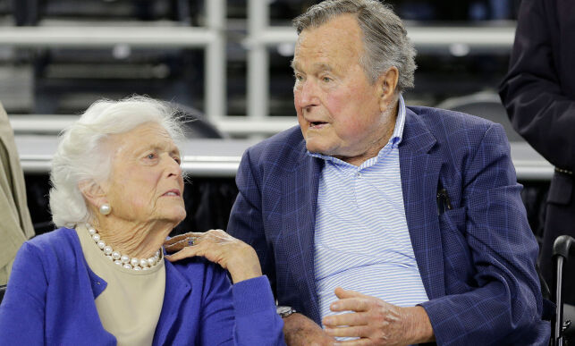 """FILE - In this March 29, 2015, file photo, former President George H.W. Bush and his wife Barbara Bush, left, speak before a college basketball regional final game between Gonzaga and Duke, in the NCAA basketball tournament in Houston. A family spokesman said Sunday, April 15, 2018, that the former first lady Barbara Bush is in """"failing health"""" and won't seek additional medical treatment. (AP Photo/David J. Phillip, File)"""