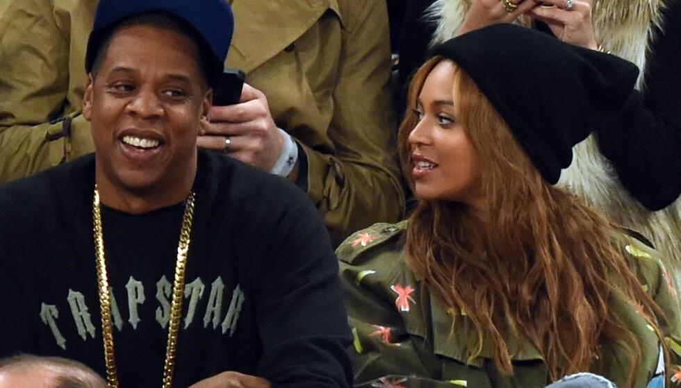 ANKLAGES: Strømmetjenesten Tidal, som blant annet eies av rapperen Jay Z (t.v.) anklages for å ha manipulert lyttertallene til blant andre kona hans, Beyoncé. Foto: AFP PHOTO / TIMOTHY A. CLARY