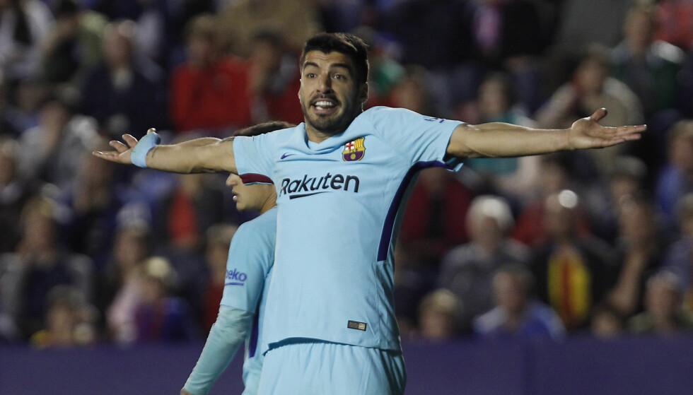 SJOKKTAP: Luis Suarez og Barcelona gikk på sesongens første tap. Foto: AP / Alberto Saiz