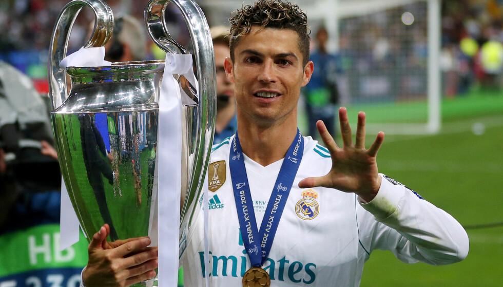 FEM: Cristiano Ronaldo feiret sin femte Champions League-tittel lørdag. Foto: REUTERS/Hannah McKay