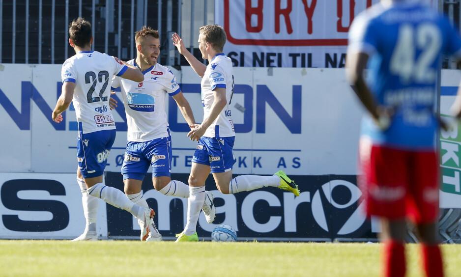 JUBEL: Fredrik Gytkjær (i midten) jubler etter 1-0 målet i eliteseriekampen mellom FK Haugesund og TromsøNess, Jan Kåre / NTB scanpix