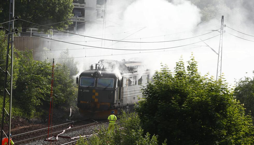 BRANT: En person fikk i seg noe røyk under brannen. Foto: Terje Pedersen / NTB scanpix