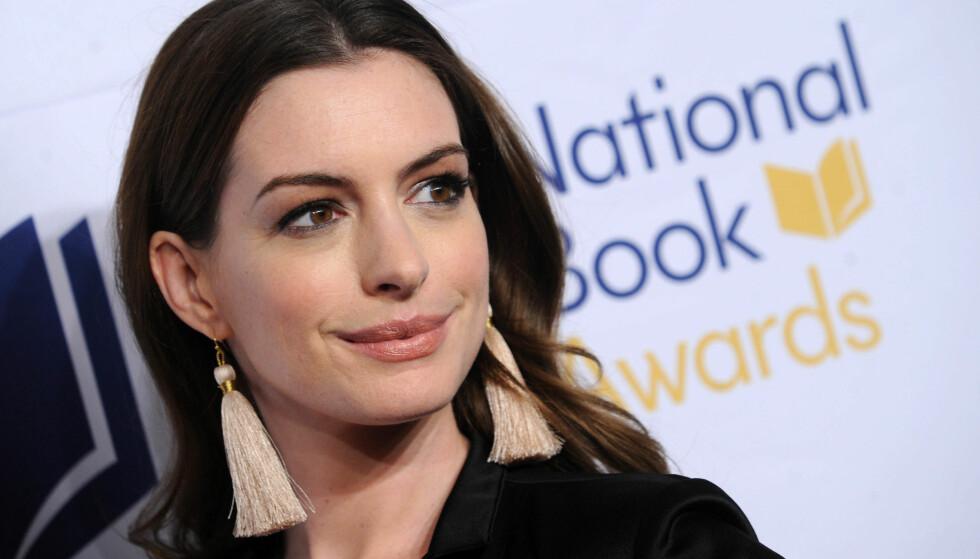 FØLTE SEG PRESSET: Skuespiller Anne Hathaway valgte å forklare hvorfor hun hadde gått opp i vekt før noen påpeker det og spekulerer på om hun er gravid. Foto: NTB Scanpix