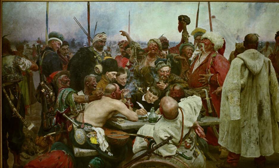 KJENT VERK: Et av Ilja Repins store bilder er «Zaporosja-kosakkene skriver brev til sultanen», fra 1885.  Det skildrer en historisk scene fra 1676, der de svarer på et brev fra sultanen i Istanbul, der han krever underkastelse fra kosakkene.