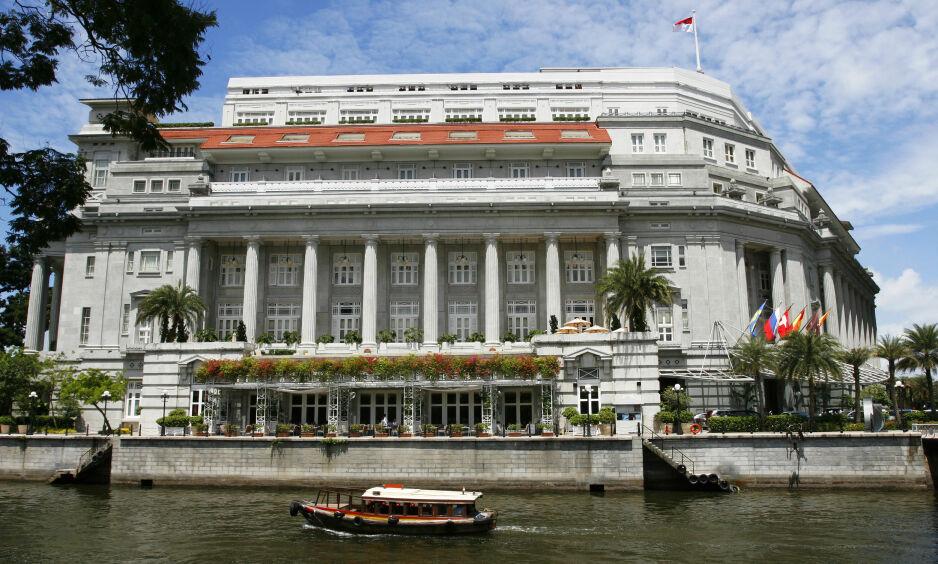LUKSUS: Dette hotellet, Fullerton Hotel i Singapore, ønsker Kim Jong-un å overnatte på når han skal møte Donald Trump seinere denne måneden. Det er et femstjerners hotell, som har 400 rom, fem matserveringer og luksusspa. Foto: Shutterstock / NTB Scanpix