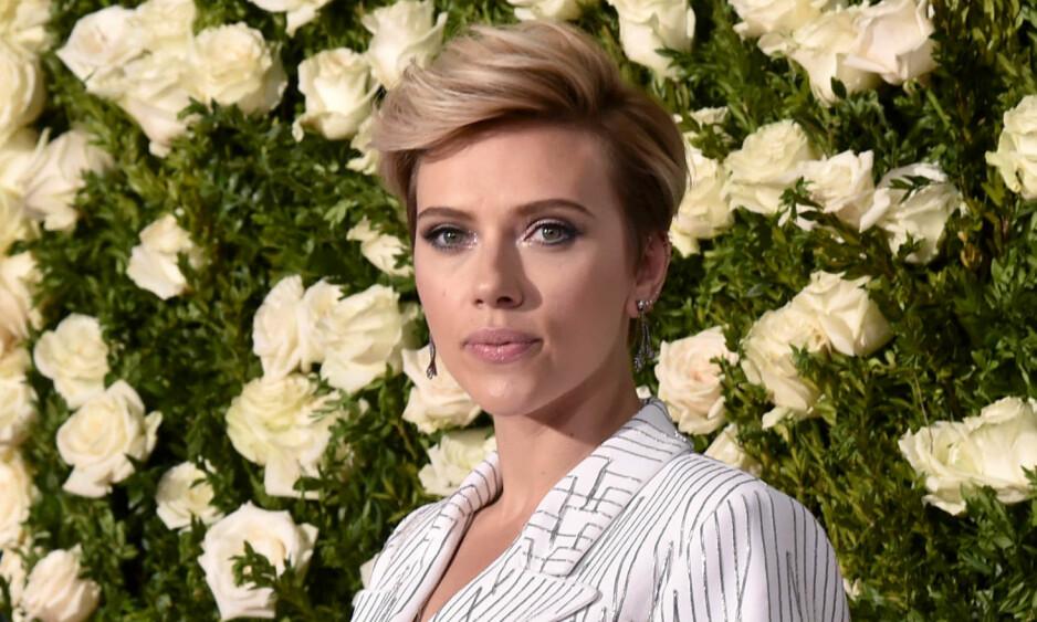 RASER: Scarlett Johansson svarer på ryktene om at hun gikk på audition for å få date Tom Cruise. Foto: NTB scanpix