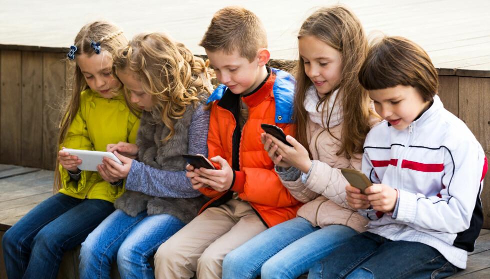 TID FORAN SKJERMEN: Hvor mye tid kan barna bruke foran skjermen? Forskere har funnet frem til svaret. Foto: Shutterstock / NTB scanpix